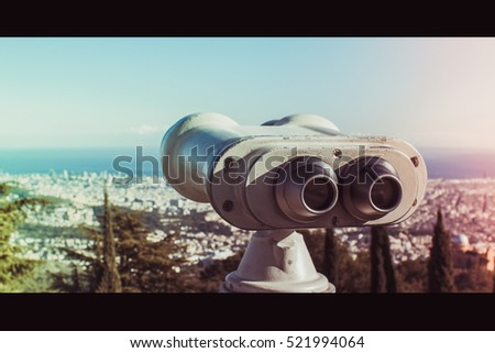 Barcelona, Spain. November 23, 2016 - Coin operated binoculars and panoramic view of the city on a sunny day