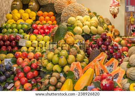 BARCELONA, SPAIN - NOVEMBER 10, 2014: Different kind of fruit at La Boqueria market,  one of the foremost tourist landmarks