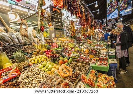BARCELONA, SPAIN - NOVEMBER 16, 2013: Famous La Boqueria market - one of the oldest markets (Established in 1217) in Europe that still exist. A huge selection of seafood.
