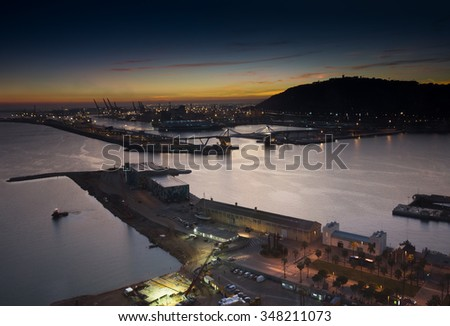 BARCELONA, SPAIN - NOVEMBER 10, 2015: Panoramic view of the Adossat cruise wharf and cargo port of Barcelona on November 10, 2015 in Barcelona, Spain. It is Catalonia's largest port