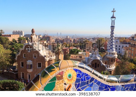 Barcelona, Spain - November 10, 2015: Park Guell entrance buildings and mosaic bench. The Park Guell is a public park system composed of gardens and architectonic elements, designed by Antoni Gaudi.