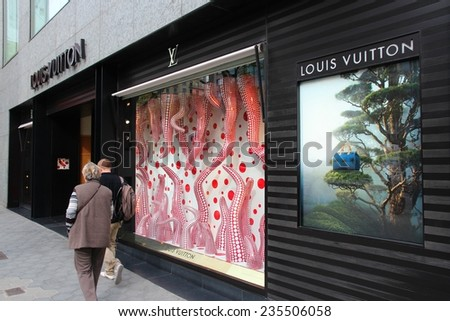 BARCELONA, SPAIN - NOVEMBER 6, 2012: People visit Louis Vuitton store on in Barcelona, Spain. Louis Vouitton was most powerful luxury brand in world with $19.4bn USD value (Forbes 2008). - stock photo