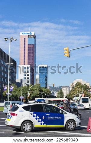 Barcelona, Spain - November 7, 2014: Police car in a square in Barcelona. This police force is called Guardia Urbana de Barcelona and one of its functions is to control the traffic in the city - stock photo