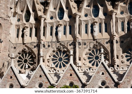 BARCELONA, SPAIN - NOVEMBER 12, 2013: Sagrada Familia south side. Church of the Holy Family, architecture by Antoni Gaudi - stock photo