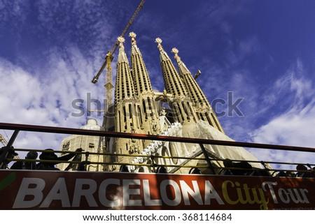 BARCELONA, SPAIN - NOVEMBER 18, 2015: The Basilica Sagrada Familia is a large Roman Catholic church in Barcelona, Spain, designed by Catalan architect Antoni Gaudi - stock photo