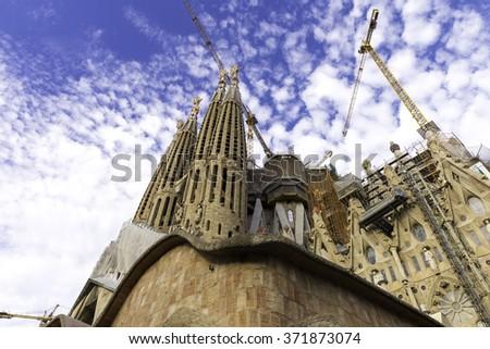 BARCELONA, SPAIN - NOVEMBER 18, 2015: The church Sagrada Familia is a large Roman Catholic church in Barcelona, Catalonia, Spain, designed by Catalan architect Antoni Gaudi - stock photo