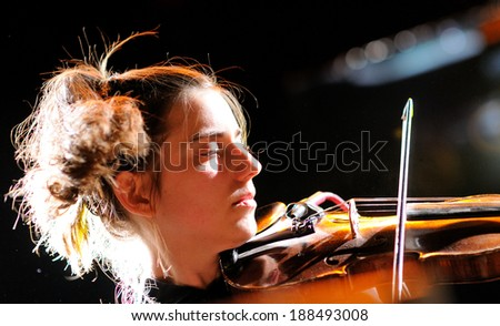 BARCELONA, SPAIN - OCT 14: Cathy Lucas, violinist of Fanfarlo band, performs at Apolo on October 14, 2012 in Barcelona. - stock photo