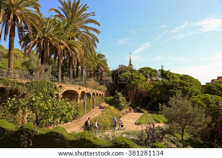 BARCELONA, SPAIN - October 2: Ceramic mosaic Park Guell on October 2, 2015 in Barcelona, Spain. Park Guell is the famous architectural town art designed by Antoni Gaudi, and is popular with tourists. - stock photo