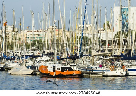 BARCELONA, SPAIN - OCTOBER 6, 2014: Detail of numerous sports boats anchored in the Maremagnum, Marina City. - stock photo
