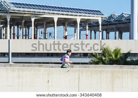 Barcelona, Spain - October 31, 2015: Mature man practicing jogging in Barcelona, Catalonia, Spain - stock photo