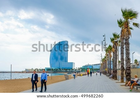 Barcelona, Spain - October 5, 2016: panoramic view on Barceloneta with modern architecture buildings sand beach on sunny day.