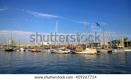 BARCELONA, SPAIN - OCTOBER 11: Port Vell in Barcelona, Spain on October 11, 2015. It is the old harbor of Barcelona with an area of sports boats, dock and a shopping area.