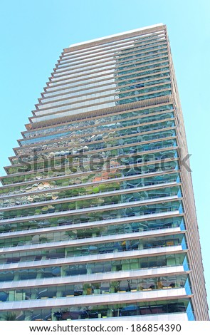 BARCELONA, SPAIN - OCTOBER 08: Torre Mapfre is a skyscraper in the Olympic Port of Barcelona on October 08, 2013 in Barcelona, Spain. It is named after its owner, Mapfre, an insurance company