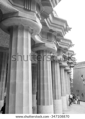 BARCELONA, SPAIN - OCTOBER 1, 2008: Tourist visiting the Parc Guell designed by Gaudi in black and white