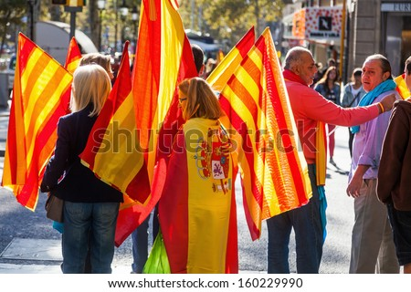 BARCELONA, SPAIN - OCTOBER 12: unidentified people with Catalan flags on October 12, 2013 in Barcelona. day is the National Spain Day and more than 10.000 people demonstrated for the Spain union.