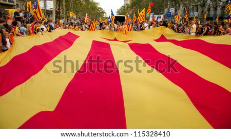 BARCELONA, SPAIN - SEPT. 11: Participants in the rally for the independence during the National Day of Catalonia on Sept. 11, 2012 in Barcelona, Spain. About 1.5 million people participated.