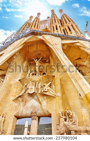 BARCELONA, SPAIN - SEPT 02, 2014: The Basilica of La Sagrada Familia against blue sky.Most amazing  and fabulous creations of the great architect  by Antoni Gaudi. Barcelona, September 02, 2014. - stock photo