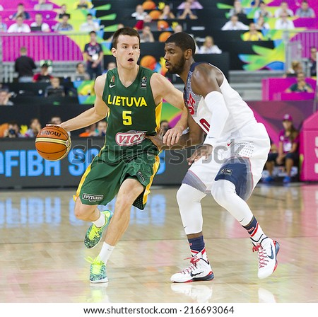 BARCELONA, SPAIN - SEPTEMBER 11: Adas Juskevicius of Lithuania (5) at FIBA World Cup basketball match between USA Team and Lithuania, final score 96-68, on September 11, 2014, in Barcelona, Spain. - stock photo
