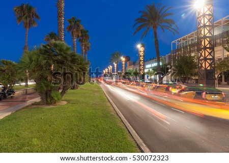 BARCELONA, SPAIN,SEPTEMBER 17;  Buses and vehicles drive along Olympic Port district Barcelona road to coast through the commercial area.