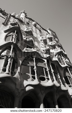 BARCELONA, SPAIN - SEPTEMBER 9, 2009: Casa Batllo seen from public street in Barcelona, Spain. It was designed by famous Antonio Gaudi. Barcelona is the most visited city in Spain. - stock photo