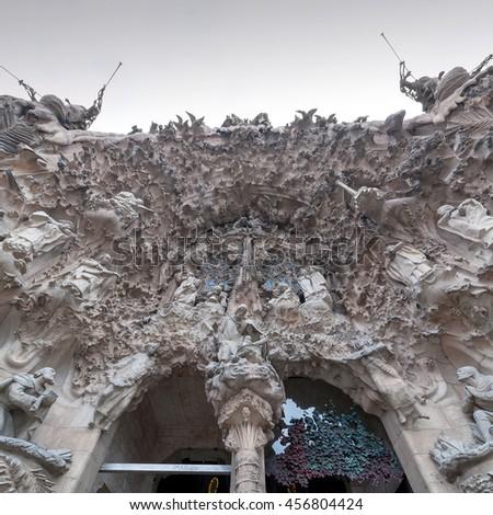 BARCELONA, SPAIN - SEPTEMBER 22, 2014: Detail view of Facade of Sagrada Familia in Barcelona, Spain. Roman Catholic church designed by Catalan architect Antoni Gaudi. - stock photo