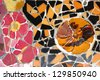 BARCELONA, SPAIN - SEPTEMBER 8: Floral mosaic in Park Guell on September 8, 2009 in Barcelona, Spain. It was designed by famous Antonio Gaudi. Barcelona is the most visited city in Spain. - stock photo