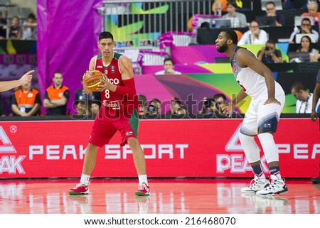 BARCELONA, SPAIN - SEPTEMBER 6: Gustavo Ayon of Mexico Team (L) at FIBA World Cup basketball match between USA and Mexico, final score 86-63, on September 6, 2014, in Barcelona, Spain. - stock photo