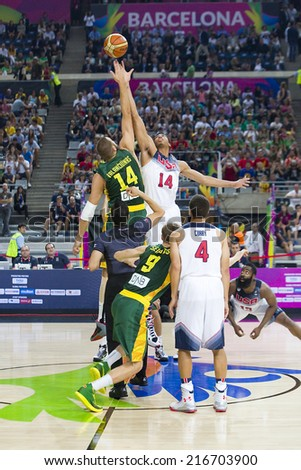 BARCELONA, SPAIN - SEPTEMBER 11: Jonas Valanciunas and Anthony Davis (L-R) in action at World Cup basketball match between USA Team and Lithuania, 96-68, on September 11, 2014, in Barcelona, Spain. - stock photo