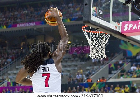 BARCELONA, SPAIN - SEPTEMBER 11: Kenneth Faried of USA in action at FIBA World Cup basketball match between USA Team and Lithuania, final score 96-68, on September 11, 2014, in Barcelona, Spain. - stock photo