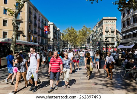 BARCELONA, SPAIN - SEPTEMBER 14: La Rambla in Barcelona, Spain. Thousands of people walk daily by this popular pedestrian area 1.2 kilometer-long