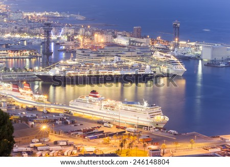 BARCELONA, SPAIN - SEPTEMBER 28, 2011: Large cruise ships in the Port of Barcelona. Night view from Montjuic hill in Barcelona, Spain.  - stock photo