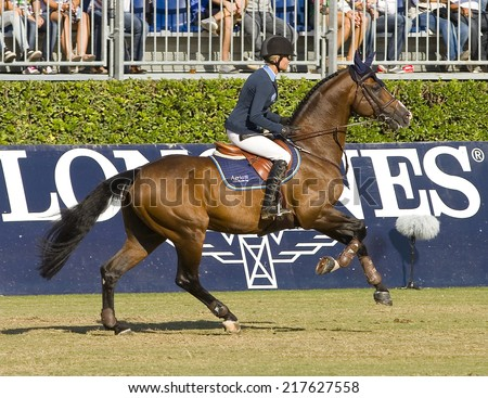 BARCELONA, SPAIN - SEPTEMBER 25: Malin Baryard Johnsson from Sweden rides horse H&M Tornesch at the 100th CSIO event at the Real Club de Polo Barcelona, on September 25, 2011, in Barcelona, Spain. - stock photo