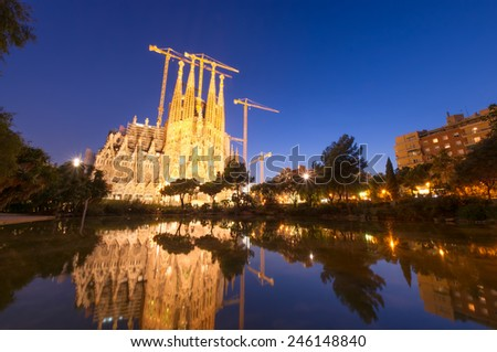 BARCELONA, SPAIN - SEPTEMBER 27, 2011: night scene, construction of Sagrada Familia, the famous cathedral designed by Antoni Gaudi. Construction in process since 19 century.   - stock photo