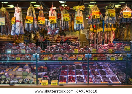 Barcelona, Spain - 18 September 2013 - One of many meat and cheese counters offering variety of products at famous La Boqueria Market in Barcelona.