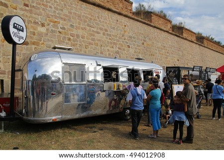 BARCELONA, SPAIN - SEPTEMBER 25, 2016: People around Montjuic castle in the city of Barcelona, for a city festival with different food trucks