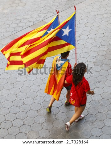 BARCELONA, SPAIN - SEPTEMBER 11, 2014: People call for Catalan independence on the 300th Catalan National Day in the streets of Barcelona, Spain on September 11, 2014. - stock photo