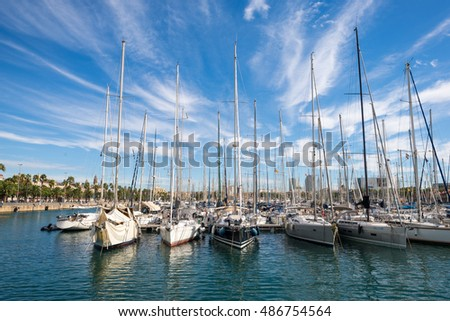 BARCELONA, SPAIN - SEPTEMBER 15. Plenty of sail boats are moored in the harbor of Port Vell in Barcelona September 15, 2016. The marina is popular and an important destination for sailing trips