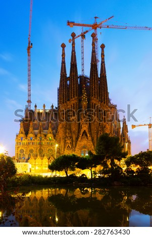 BARCELONA, SPAIN - SEPTEMBER 13, 2014: Sagrada Familia in sunset. Barcelona. Basilica and Expiatory Church of Holy Family by Gaudi, building is begun in 1882 - stock photo