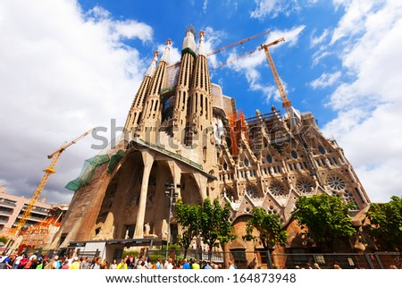 BARCELONA, SPAIN - SEPTEMBER 12: Sagrada Familia on September 12, 2013 in Barcelona, Spain.  Basilica and Expiatory Church of the Holy Family by Gaudi, building is begun in 1882