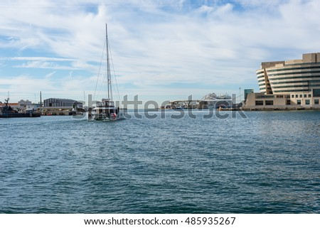 BARCELONA, SPAIN - SEPTEMBER 15. Sailboat leaves the marina Port Vell and is going to deep sea, Barcelona on September 15, 2016. The port is popular and an important destination for sail trips