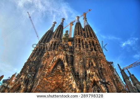 BARCELONA, SPAIN - September 29: The Sagrada Familia in HDR - the cathedral designed by Gaudi, which is being build since 1882 and is not finished yet. September 29, 2014 in Barcelona, Spain. - stock photo