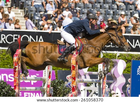 BARCELONA, SPAIN - SEPTEMBER 25: Unidentified rider at the 100th CSIO event at the Real Club de Polo Barcelona, on September 25, 2011, in Barcelona, Spain. - stock photo