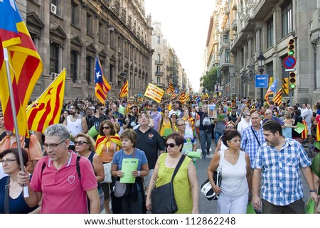 BARCELONA, SPAIN - SEPTEMBER 11: Up to a million people converge on Barcelona to join a rally demanding independence for Catalonia, on September 11, 2012, in Barcelona, Spain.