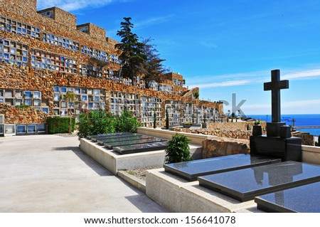 BARCELONA, SPAIN - SEPTEMBER 16: View of Montjuic Cemetery on September 16, 2013 in Barcelona, Spain. The cemetery contains over one million burials and cremation ashes in its 567,934 meters square - stock photo