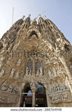 BARCELONA, SPAIN - SEPTEMBER 13, 2014: View of the highly decorated Nativity Facade of the Basilica of the Holy Family (Sagrada Familia) in Barcelona, Spain - stock photo
