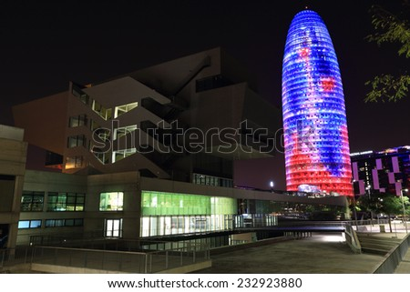 BARCELONA, SPAIN - 10th SEPTEMBER 2014: Colorful lightshow on the Torre Agbar and Placa de les Glories in downtown Barcelona, Spain. Torre Agbar was officially opened on 16 September 2005 - stock photo
