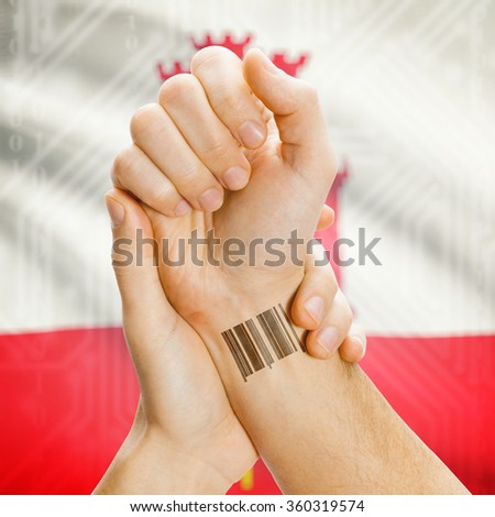 Barcode ID number on wrist of a human and national flag on background series - Gibraltar - stock photo