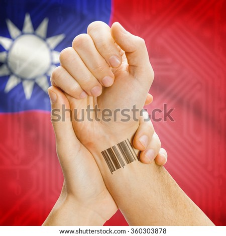 Barcode ID number on wrist of a human and national flag on background series - Taiwan - stock photo