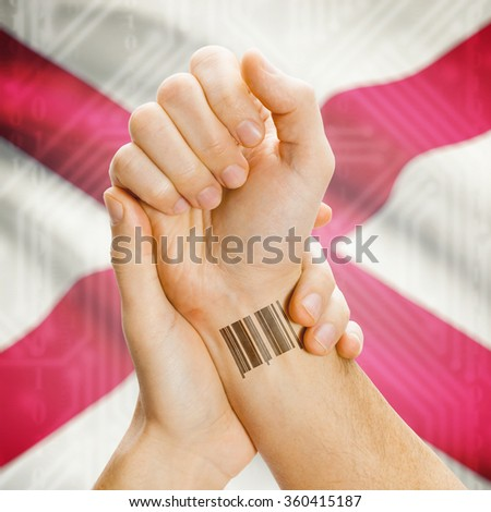 Barcode ID number tattoo on wrist and USA states flag on background series - Alabama