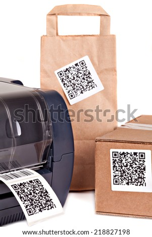 Barcode printer and packaging boxes marked with a bar code .Barcode for use - no copyright issues as constructed. - stock photo